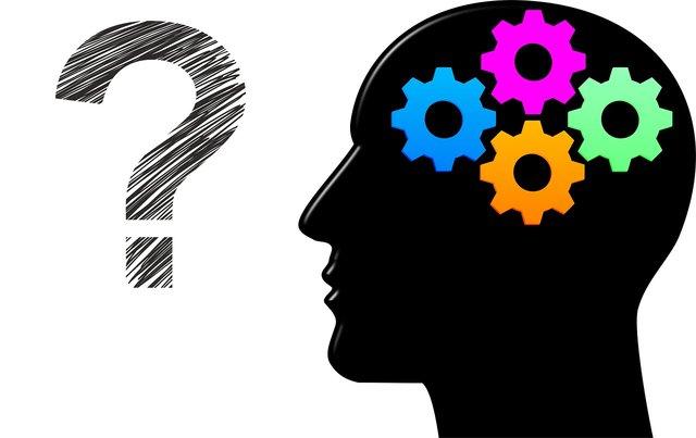 Denken zwart hoofd met vraagteken