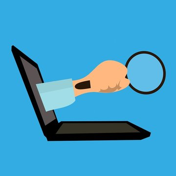 Zoeken op laptop met loep